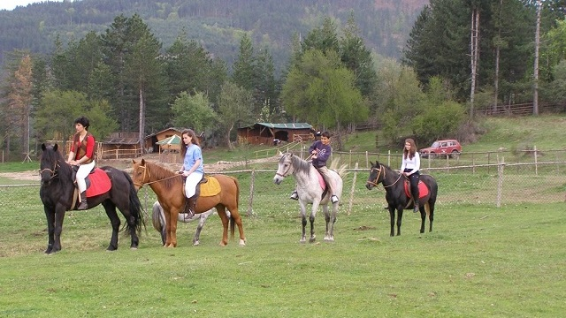 kids_riding_devin.jpg